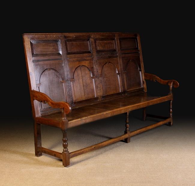 Lot 91 - An 18th Century Oak Settle.