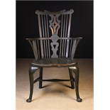 A Late 18th Century Comb Backed Windsor Armchair on cabriole legs attributed to Thames Valley area,