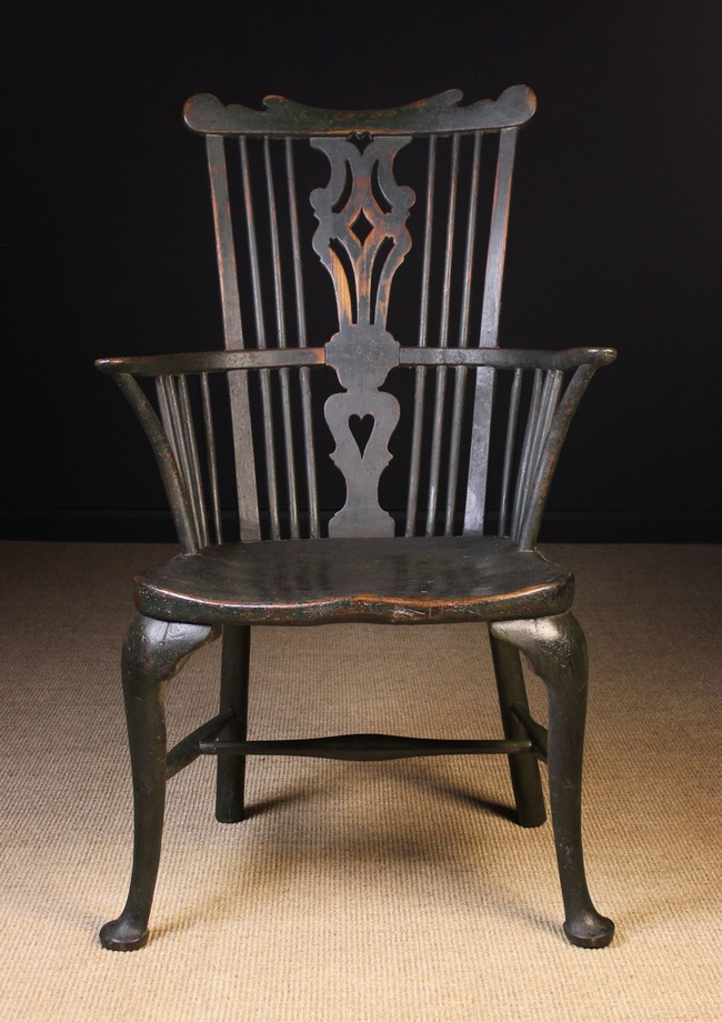 Lot 99 - A Late 18th Century Comb Backed Windsor Armchair on cabriole legs attributed to Thames Valley area,