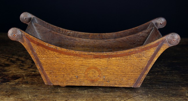 Lot 118 - A 19th Century Boarded Oak Cheese Cradle inlaid with mahogany bands.