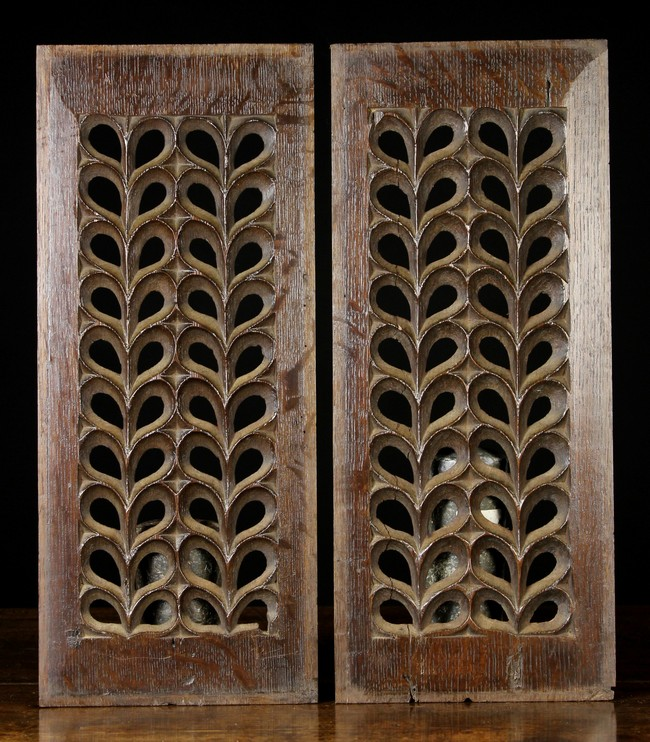 Lot 23 - A Pair of Pierced Fretwork Panels of repeated design, 18¾ ins x 8 ins (47.5 cm x 20 cms).