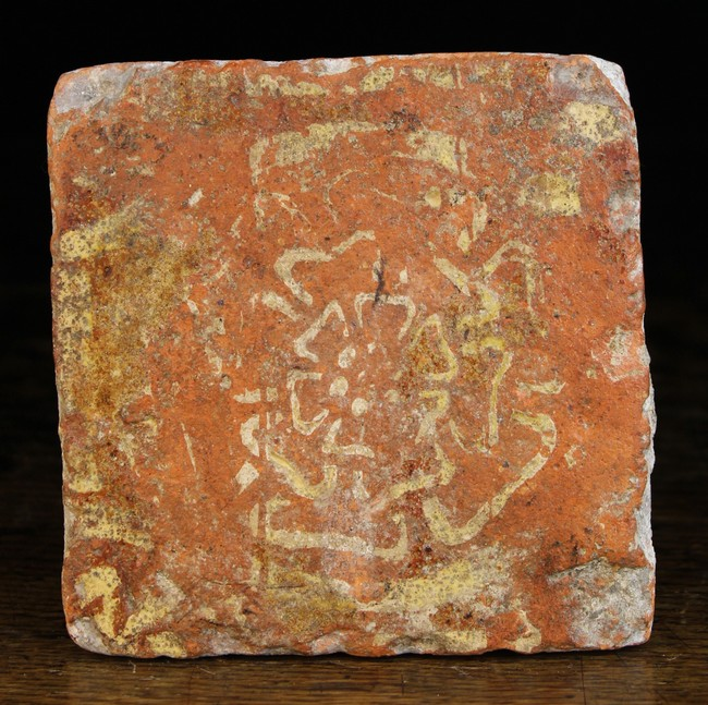 Lot 26 - A 16th Century Terracotta Tile decorated with a Tudor rose, 5 ins (13 cms) square.