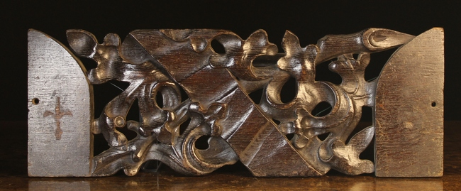 Lot 35 - A Dark Patinated Oak Fragment Panel pierced and carved with undulating Gothic foliage around a