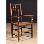 An Ash Single Row Spindle-back Rush-seat Armchair attributed to the North West, Circa 1800-70.