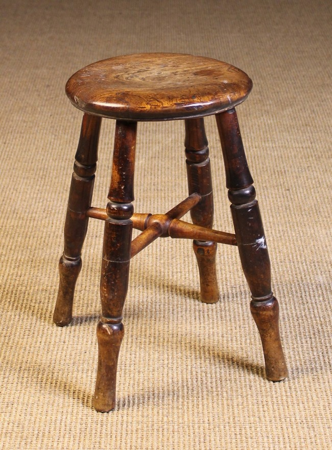 Lot 85 - A 19th Century Kitchen Stool. The round top on turned legs united by a turned X-form stretcher.