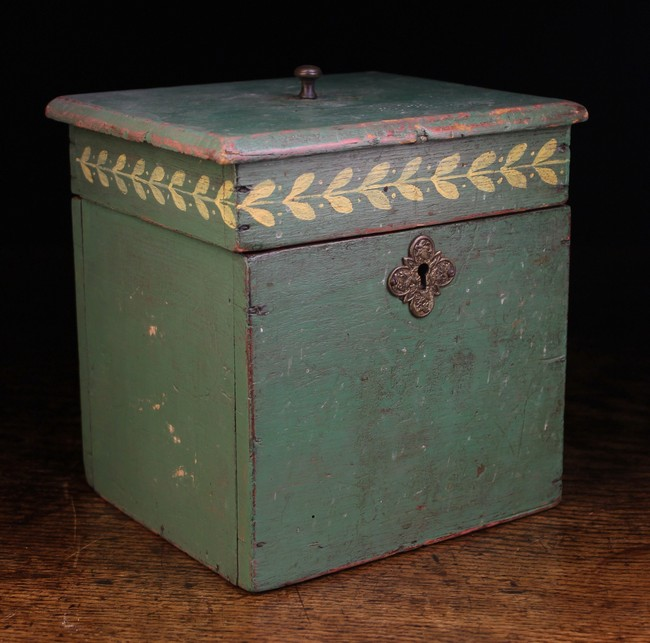 Lot 105 - A 19th Century Square Wooden Box painted green and decorated with a band of laurel leaves and