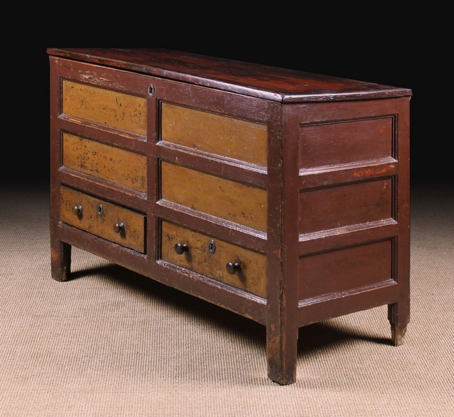 Lot 106 - A Late 18th Century Panelled Pine Mule Chest with residual paintwork.