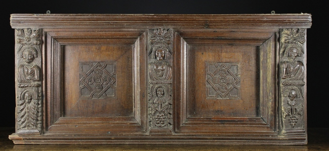 Lot 37 - A 17th Century Carved Oak Bed-head Section comprising of two recessed panels centred by squares of