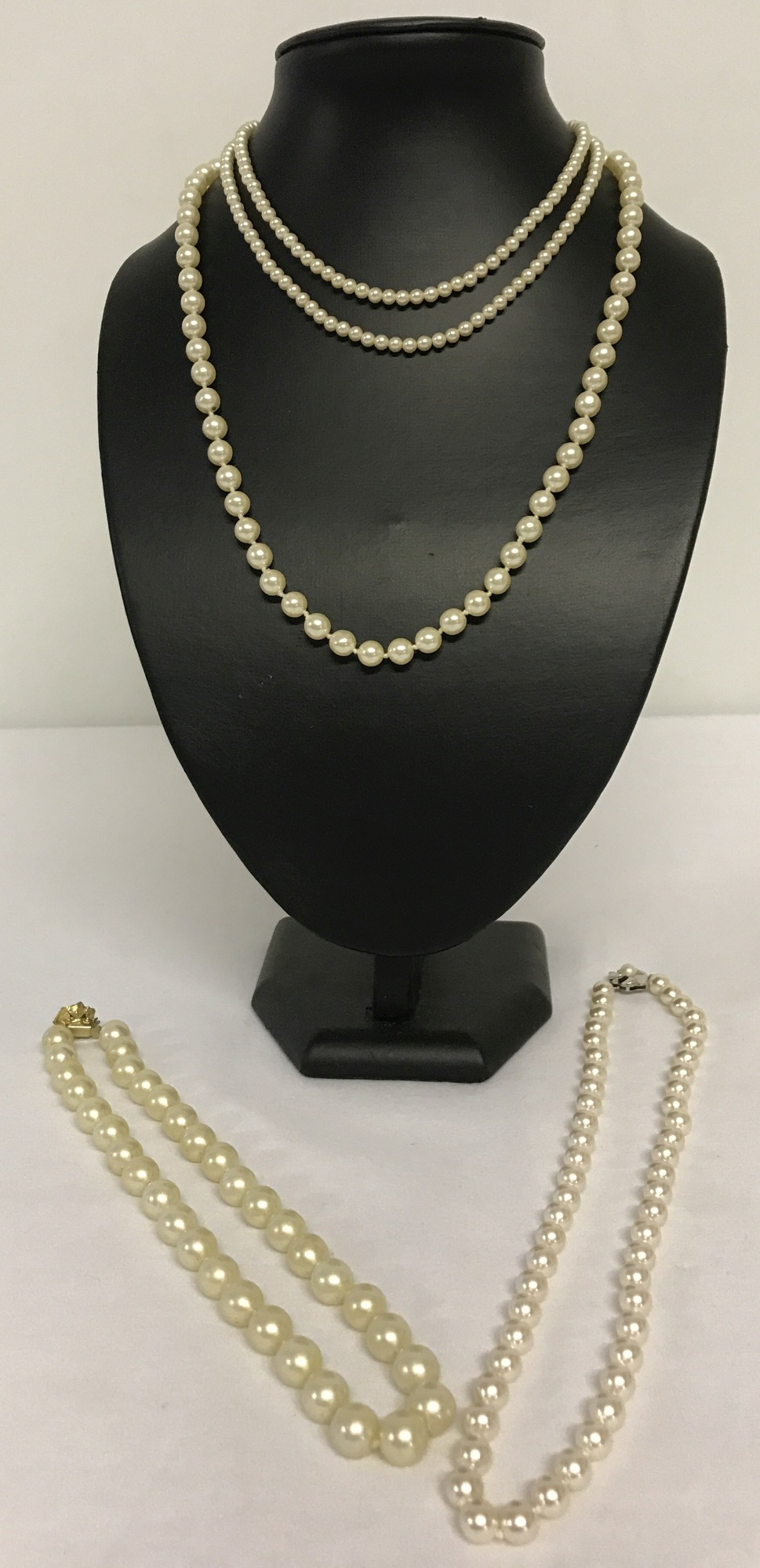 4 vintage faux pearl necklaces all with decorative clasps. One marked 925.