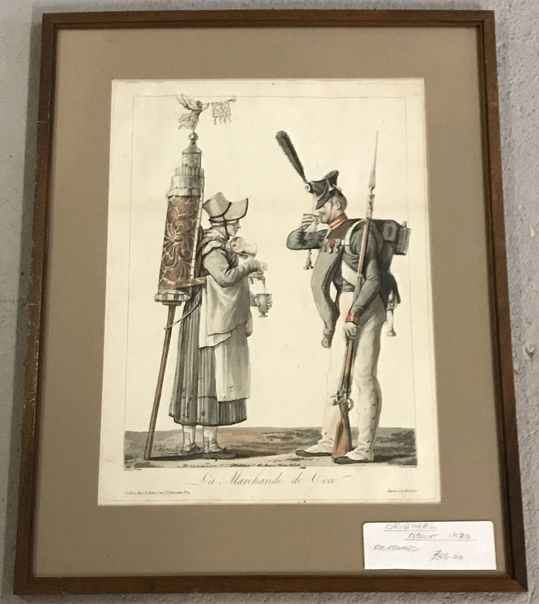 A framed and glazed engraving of a Chocolate seller and a soldier.