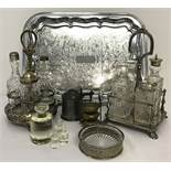 2 silver plated and cut glass cruet sets in stands.