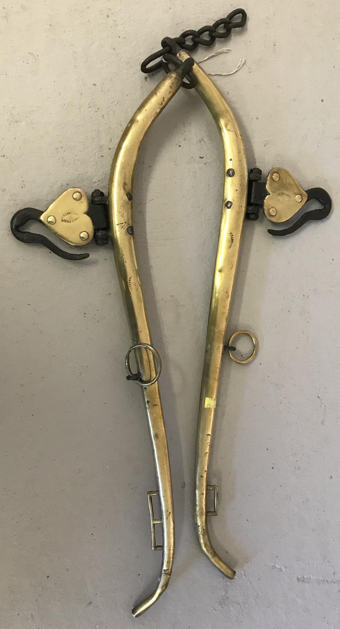 A pair of vintage brass hames.