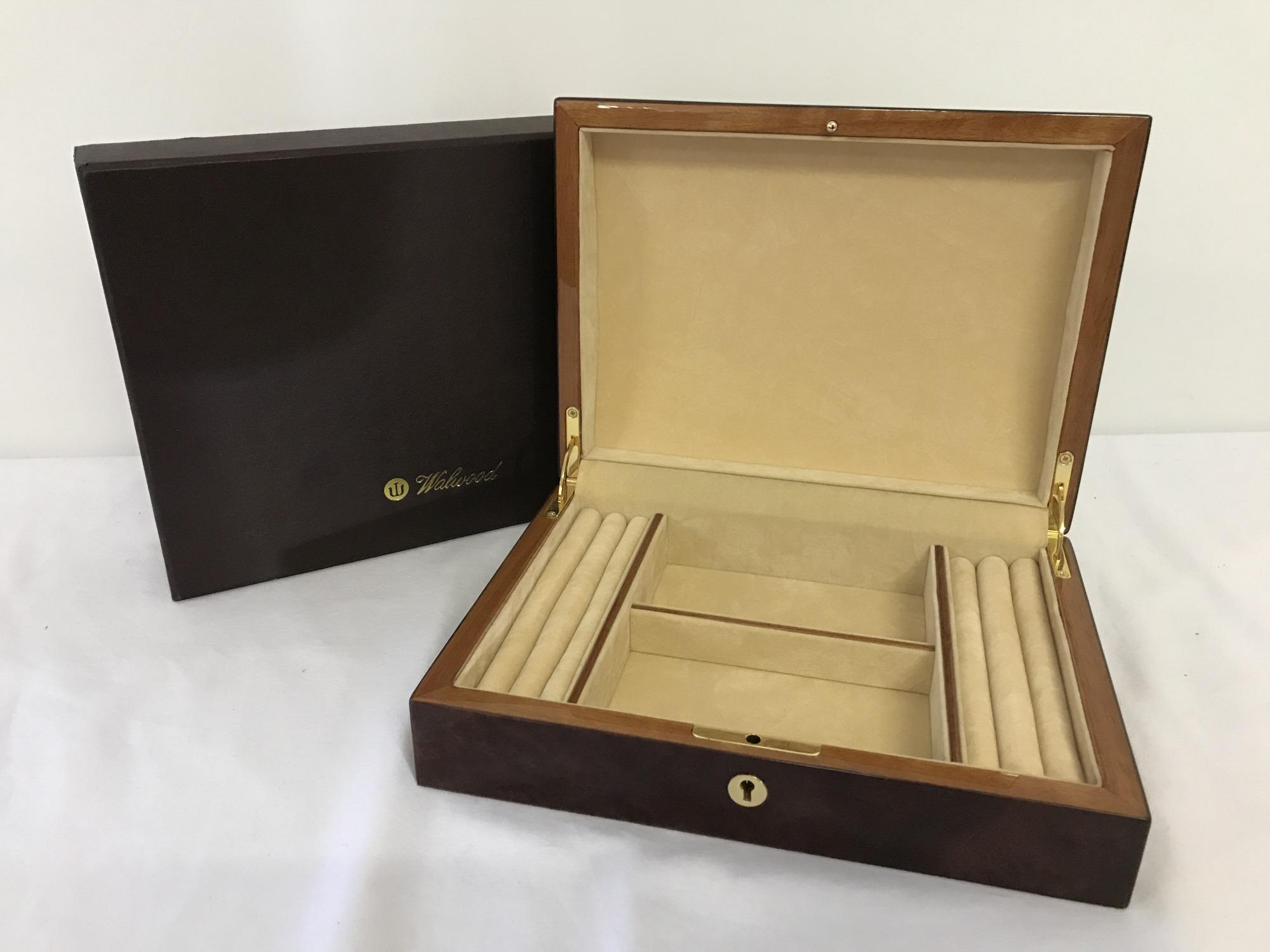 A boxed red Birdseye maple jewellery box by Walwood.