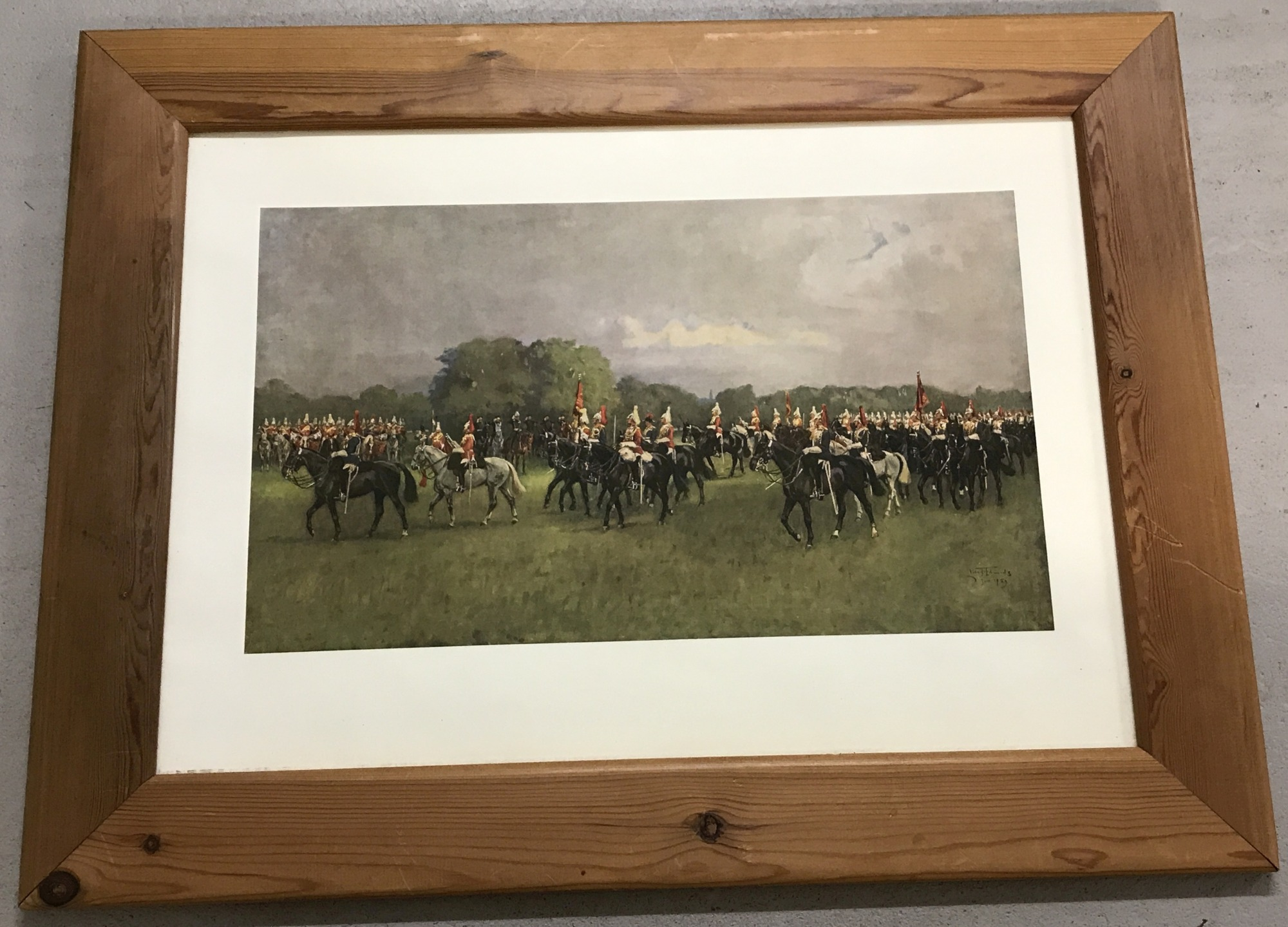 "Lot 129 - A pine framed colour military print entitled ""Trooping the Colour""."