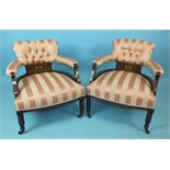 A pair of Edwardian low tub armchairs, each frame with ivory and boxwood inlay depicting cherubs,