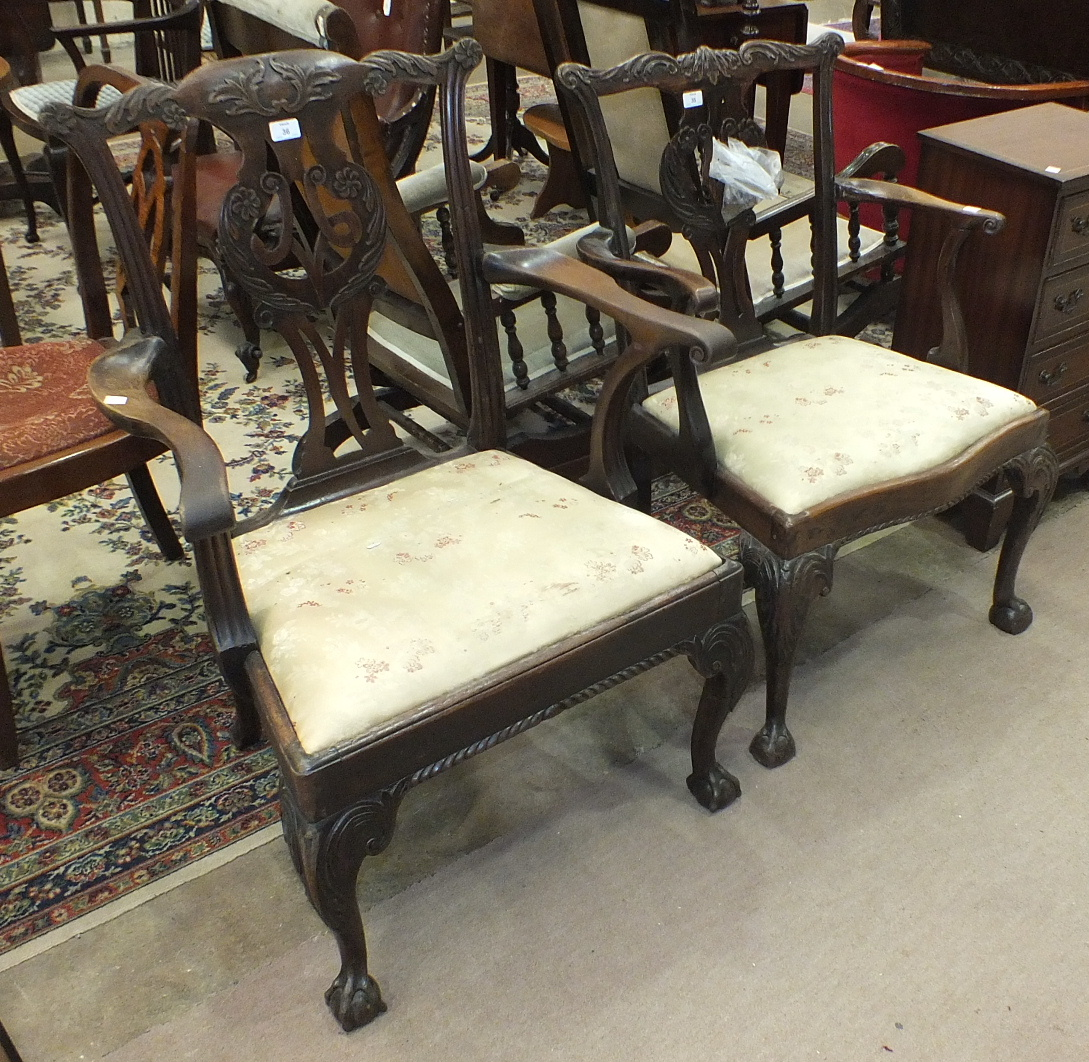 Lot 36 - An 18th century mahogany Chippendale-style elbow chair of generous proportions, with foliate pierced