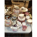 A 19th century Staffordshire pink lustre part tea set, the white body printed and painted with