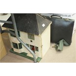 A collection of books, the contents of two boxes, a small scratch-built doll's house, 41cm wide,