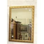 A modern gilt-framed bevelled wall mirror, 105 x 73cm.