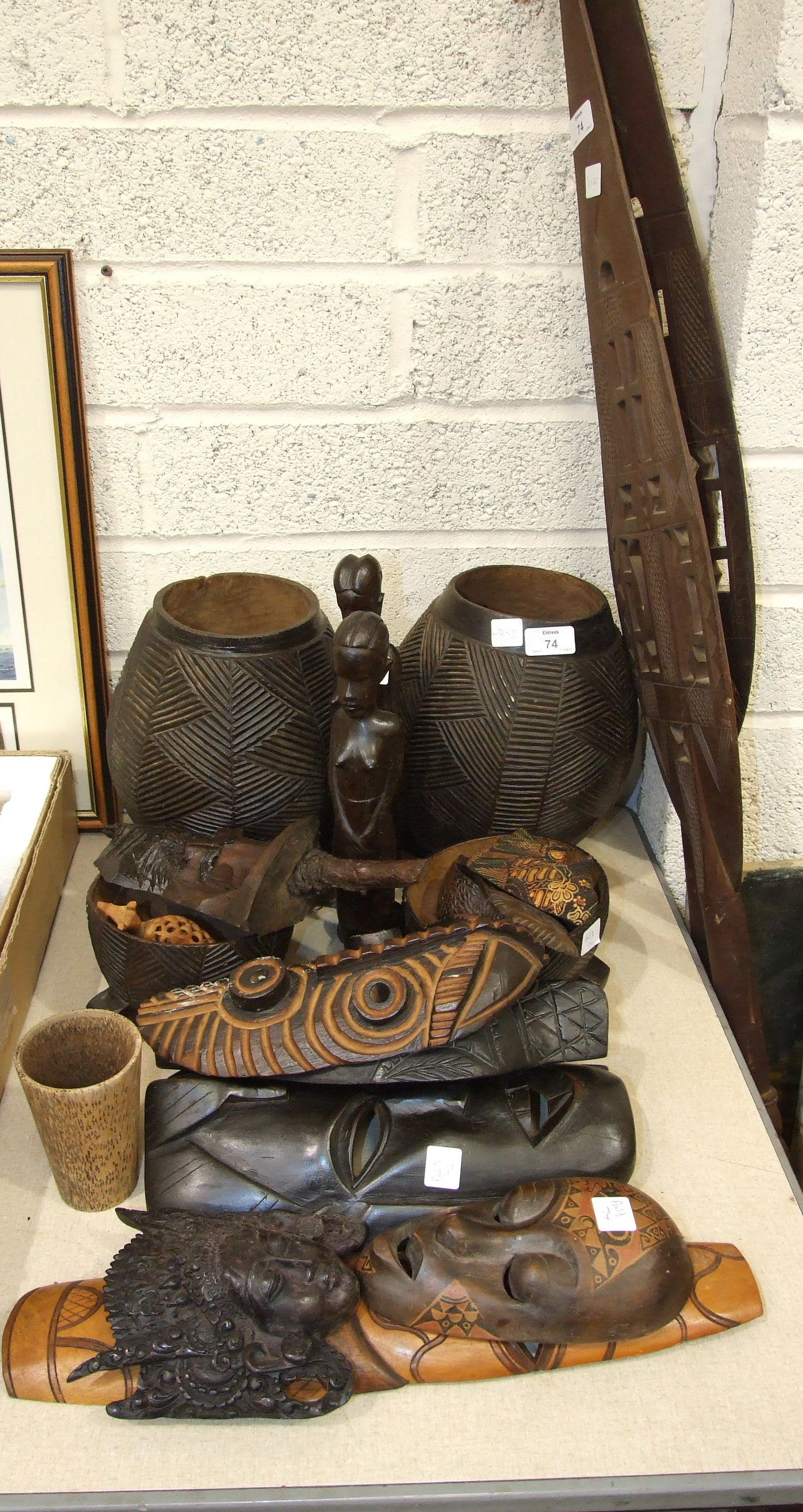 Lot 74 - A collection of mainly 20th century African wooden tribal artefacts, including two spears, mask,