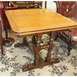An oak draw leaf dining table on turned end-supports united by a stretcher, 150 x 1=90cm open, and