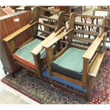 A 1950's style oak two-seater settee and two armchairs, frames only.