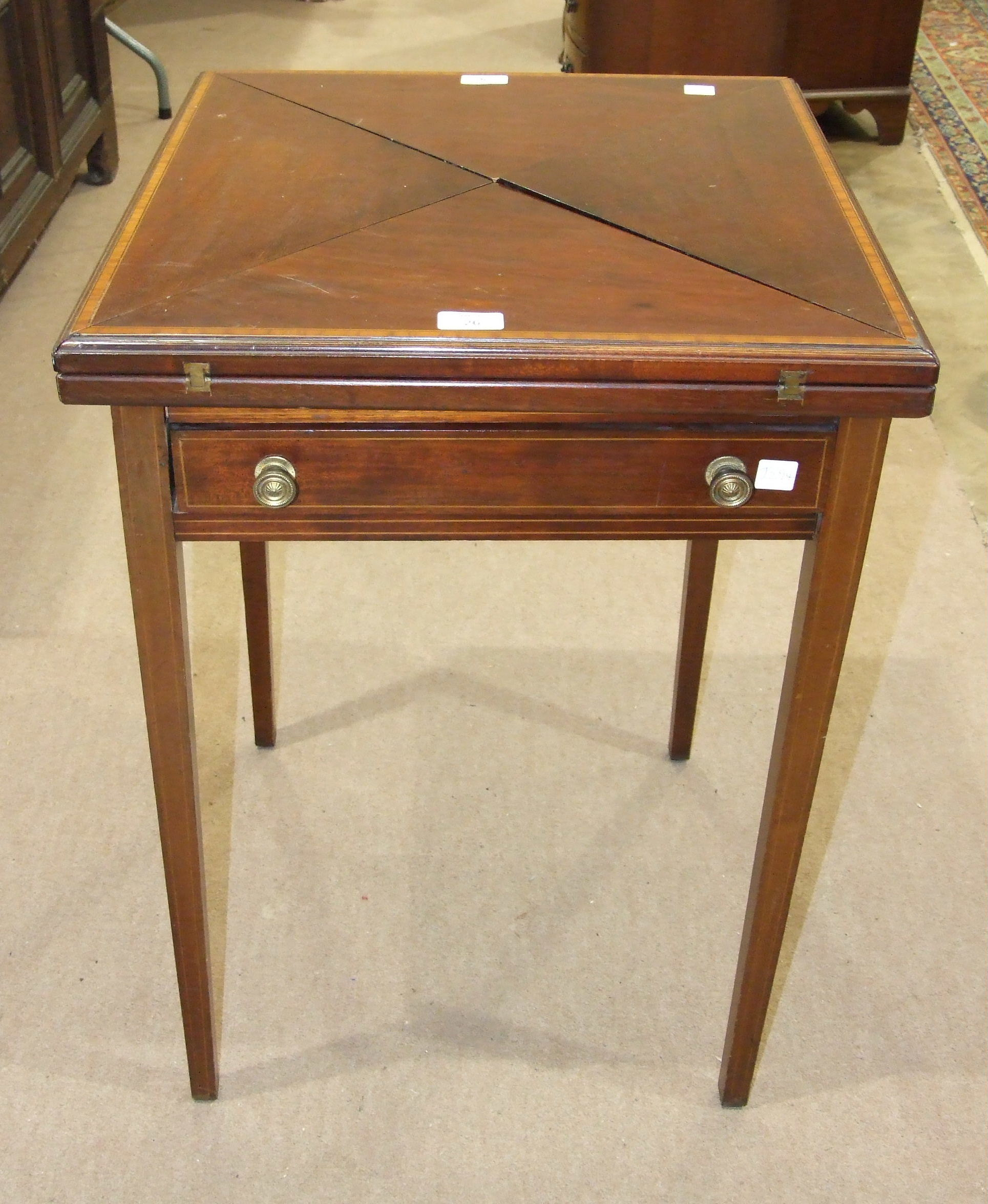 Lot 26 - An Edwardian inlaid banded mahogany envelope card table fitted with single frieze drawer, on