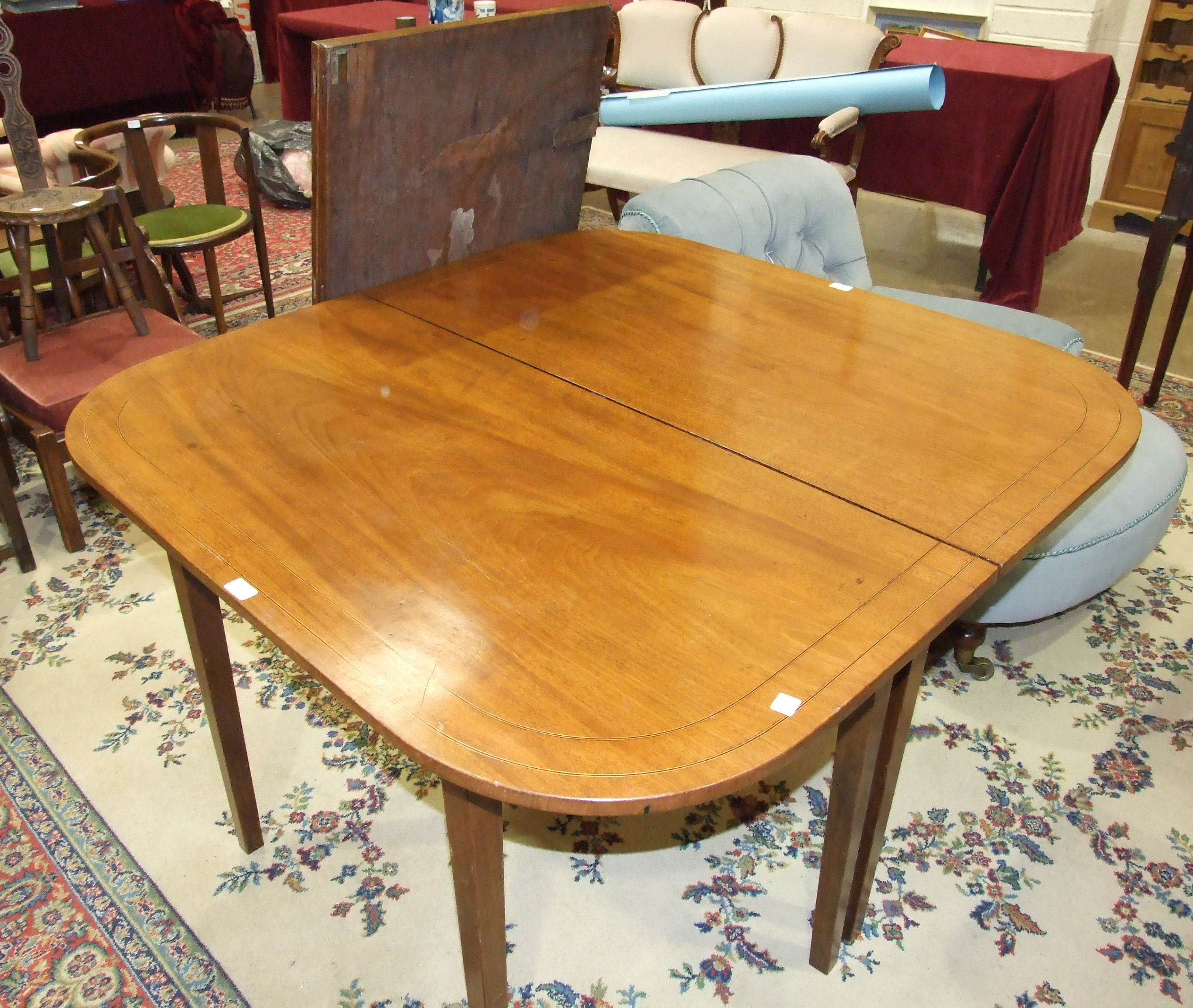 A Georgian mahogany D-end dining table on square tapering legs and having two leaves, 249 x 120cm