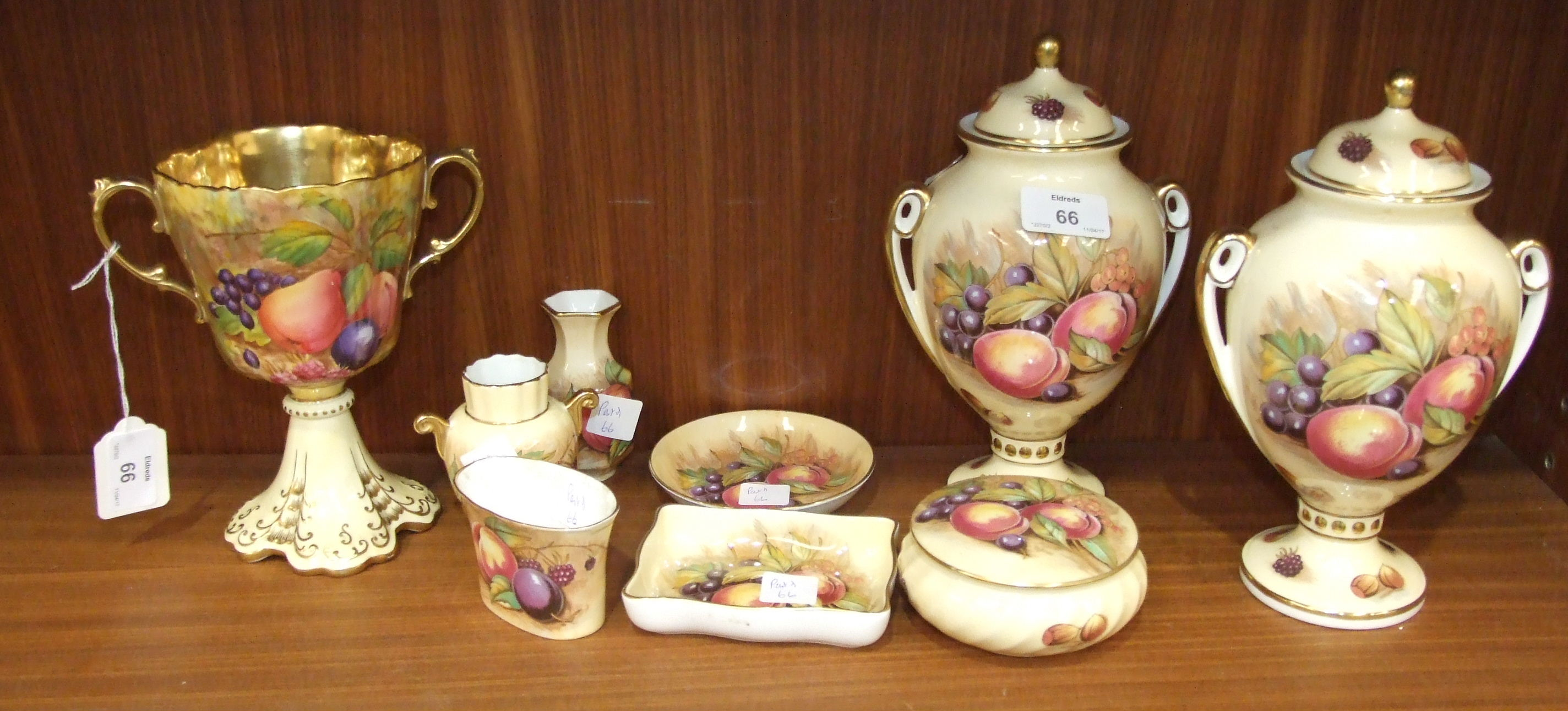 An Aynsley two-handled vase decorated with fruit by D Jones, with gilded interior, 18cm high, a pair