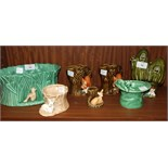 A SylvaC green glaze oval jardinière with pixie, no.2049, two tree stump with squirrel vases, no.