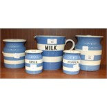 A T G Green blue and white Cornishware milk jug, two similar spice and pepper storage jars and