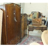 A walnut bedroom suite comprising a two-door wardrobe fitted with two drawers, 95cm wide, a
