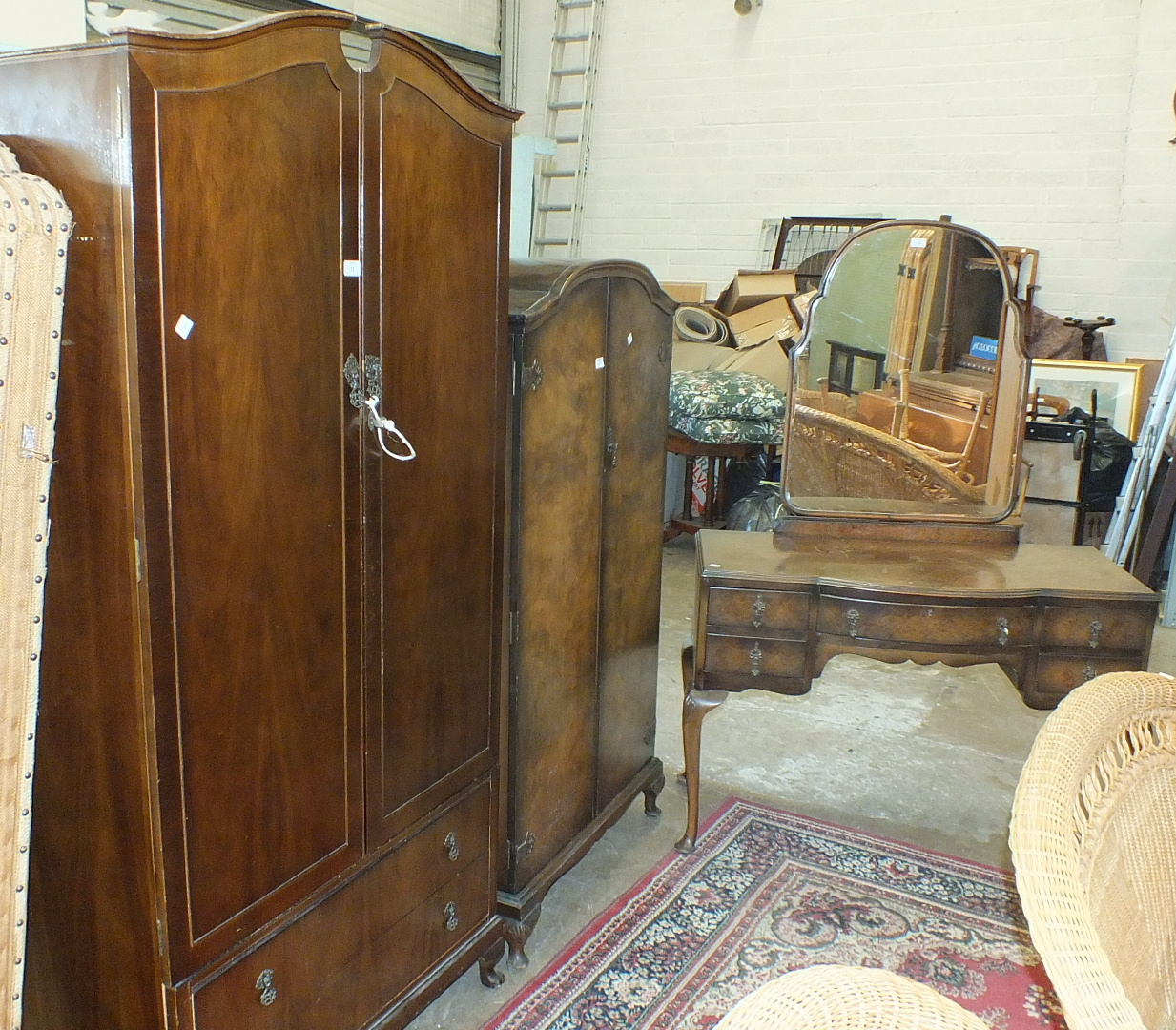 Lot 12 - A walnut bedroom suite comprising a two-door wardrobe fitted with two drawers, 95cm wide, a