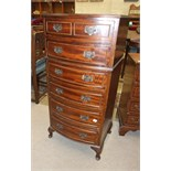 A modern mahogany finish bow-front narrow chest of six drawers on short cabriole legs, 50cm wide,