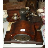 An inlaid striking mantel clock (movement damaged), a wooden model cradle, LP and 78rpm records,