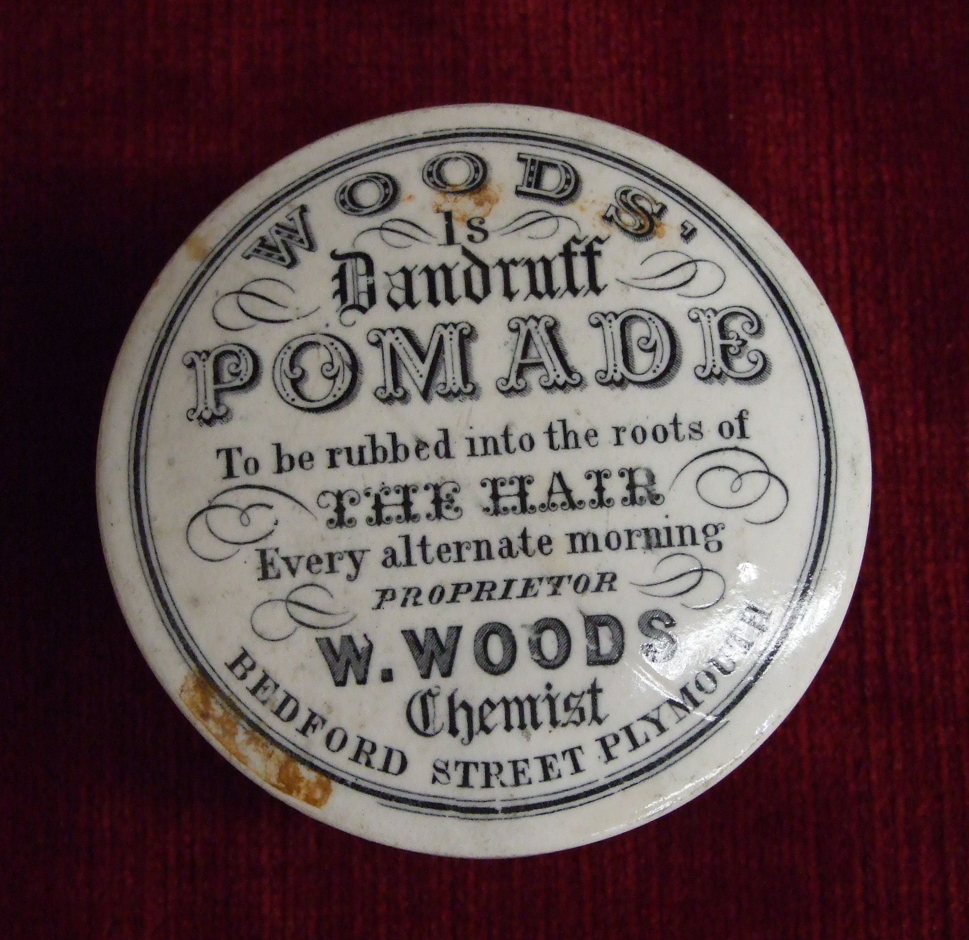 """Lot 145 - A """"Woods Is Dandruff Pomade"""" pot and lid """"To be rubbed into the roots of the hair every alternate"""