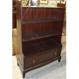 A Stag bookcase and two dressing table mirrors, (3).