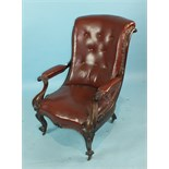 A Victorian rosewood salon chair, the foliate-carved frame with scrolling arms and Rexine-