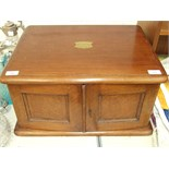 A Late-Victorian oak canteen box fitted with a pair of doors revealing three fitted graduated