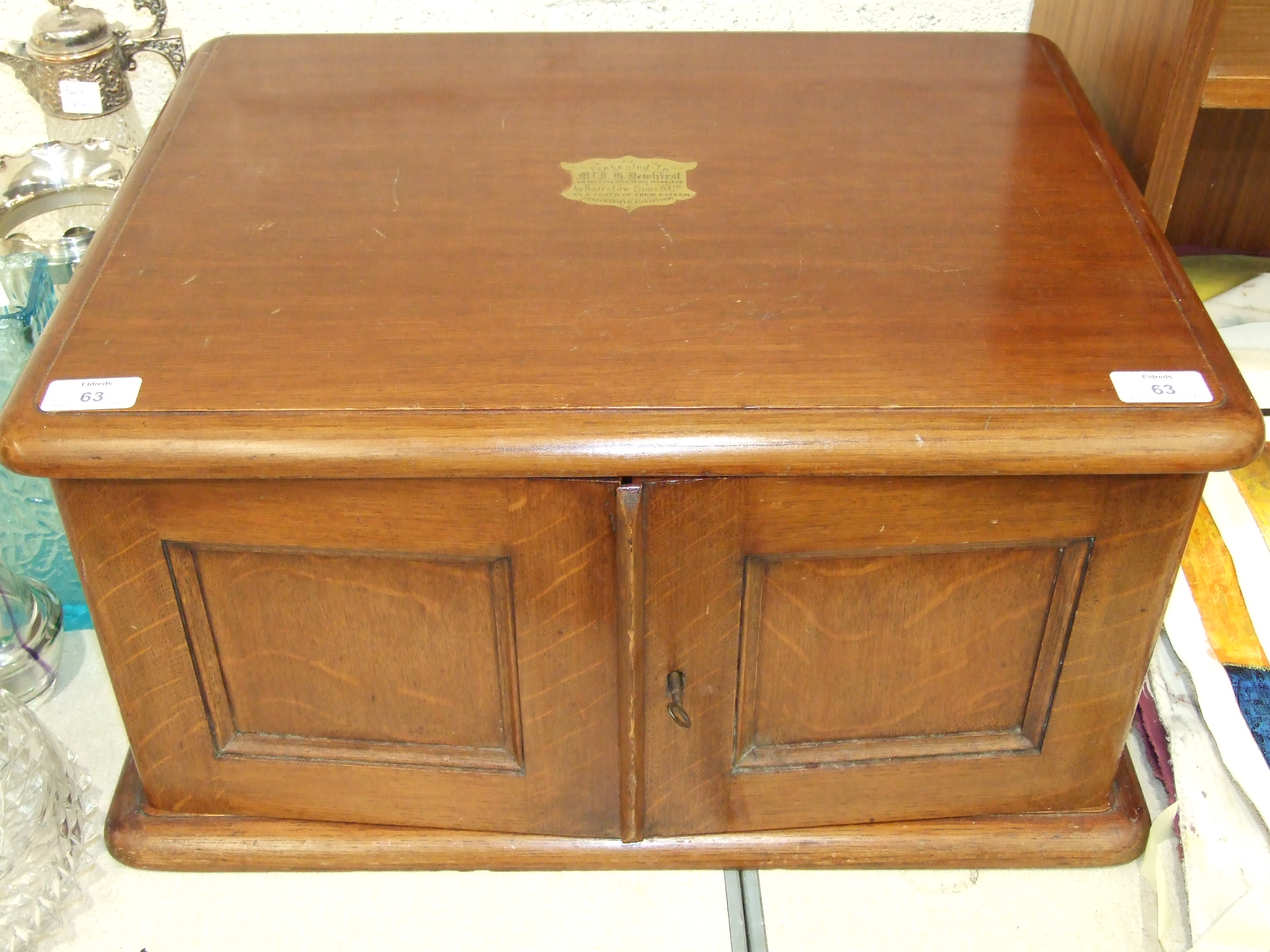 Lot 63 - A Late-Victorian oak canteen box fitted with a pair of doors revealing three fitted graduated