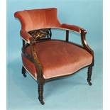 An Edwardian inlaid mahogany armchair, the upholstered high wing back and seat on square tapered