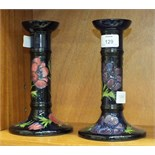 A pair of late-20th century Moorcroft Pottery candlesticks decorated with anemones on a dark blue