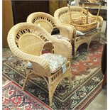A rattan two-seater conservatory settee and two matching armchairs, (3).