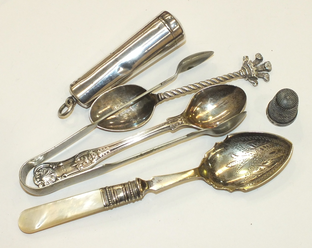 Lot 185 - A silver cheroot case with amber cheroot holder, a silver teaspoon with Prince of Wales feathers and