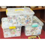 A large quantity of loose stamps contained in three plastic boxes.