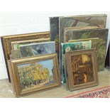 A collection of various unframed and framed oil paintings.