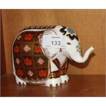 """A Royal Crown Derby paperweight, """"Imari Elephant"""", gold stopper 11cm high, boxed."""