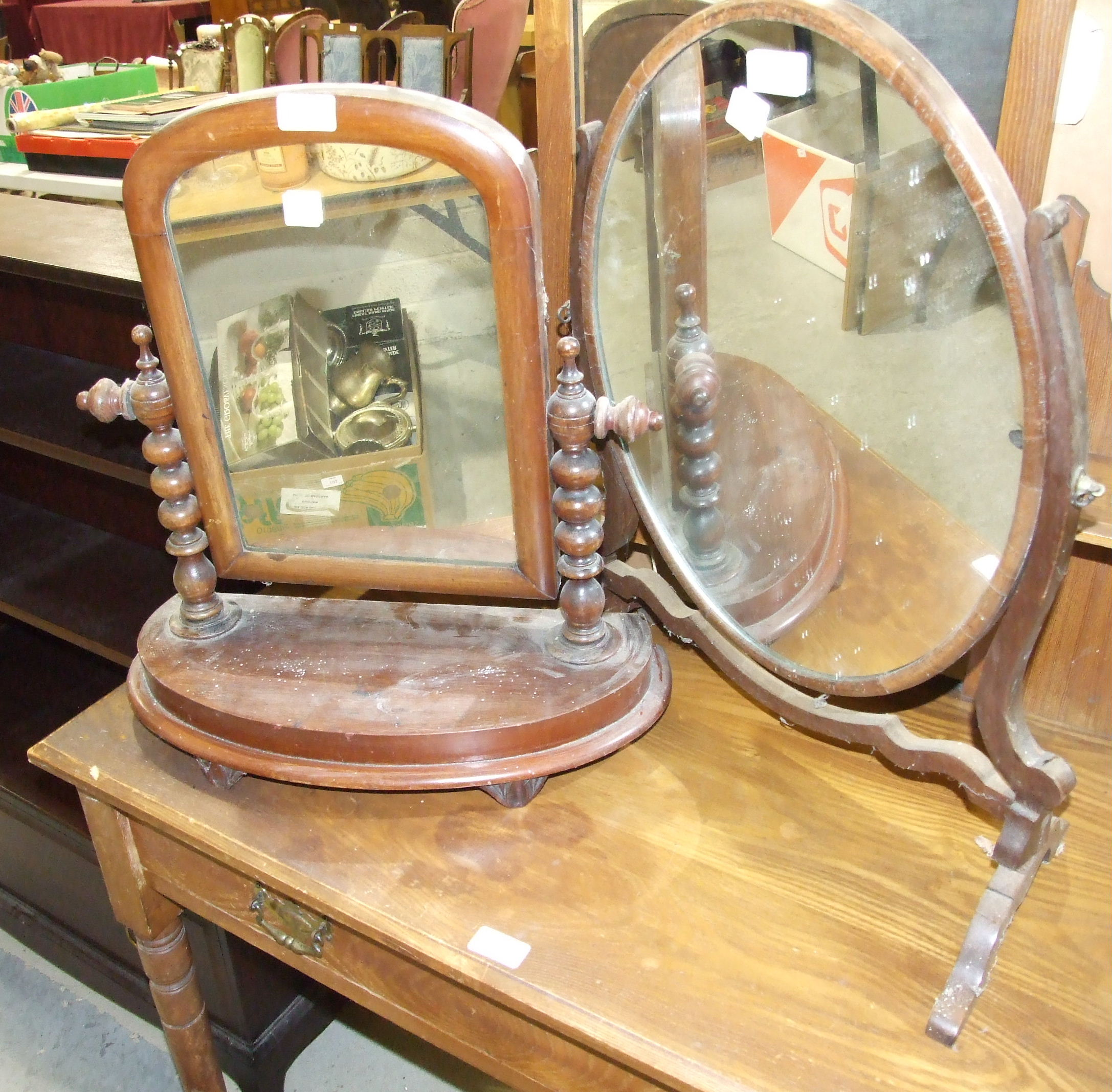 Lot 13 - A Stag bookcase and two dressing table mirrors, (3).