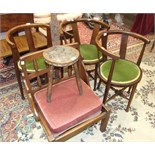 A carved oak spinning chair, stamped Ben Setter, Totnes, three stained wood armchairs with padded