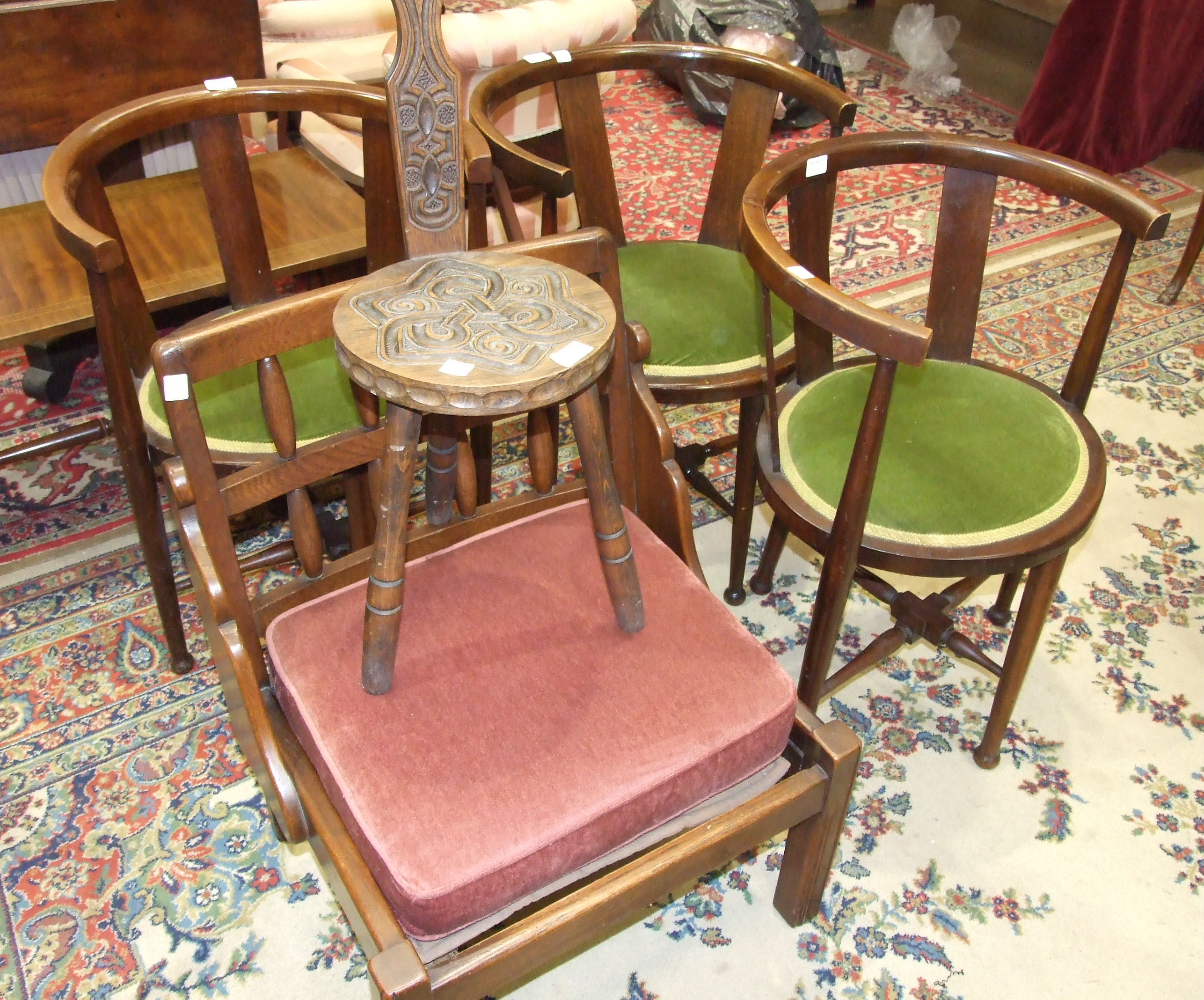 Lot 6 - A carved oak spinning chair, stamped Ben Setter, Totnes, three stained wood armchairs with padded